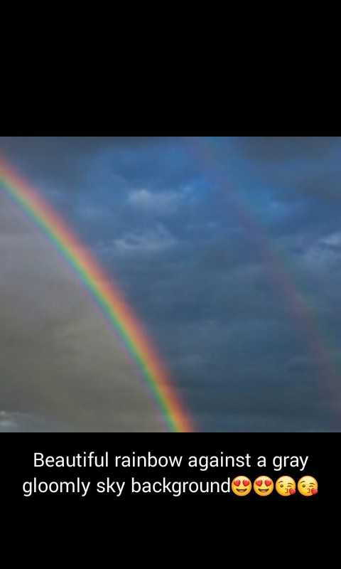 nature photography - Beautiful rainbow against a gray gloomly sky backgrounde d - ShareChat