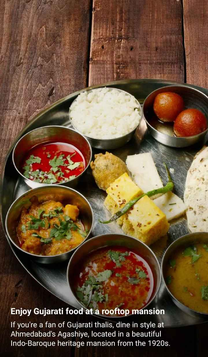 world food day - Enjoy Gujarati food at a rooftop mansion If you ' re a fan of Gujarati thalis , dine in style at Ahmedabad ' s Agashiye , located in a beautiful Indo - Baroque heritage mansion from the 1920s . - ShareChat